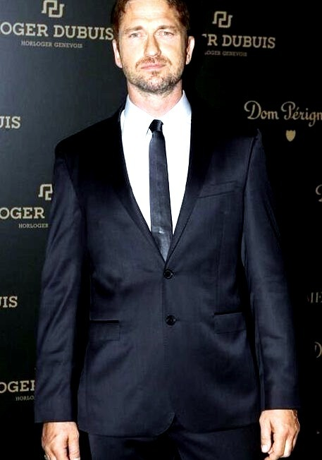 GerardButler donning a Boss Mens suit during Art Basel in Miami, Floridawww.DiscoverLavish.com