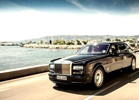 Rolls Royce on Open Highway Near Water