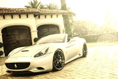 Luxury Ferrari Infront of a Mansion